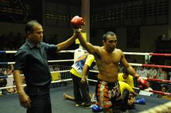 John wins with 1st round KO