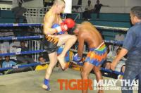 Regan land awesome knee strike to head in Tiger Muay thai fight, Phuket, thailand