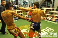 Ritt (Tiger Muay Thai) scores left hook